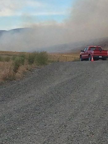 Firefighters are working to put out a fire burning off of Sheep Company Road Old Durr Road in Selah.