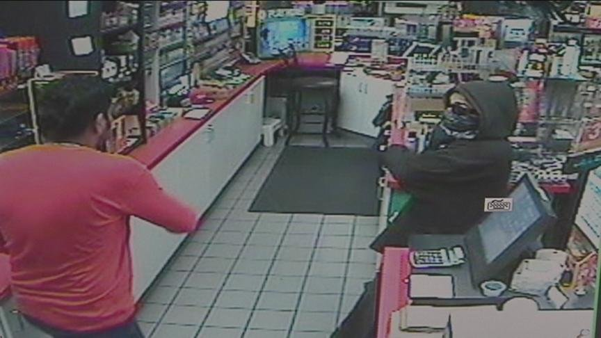 Police are searching for the man who robbed a convenience store Monday night and got up close and personal with the cashier.