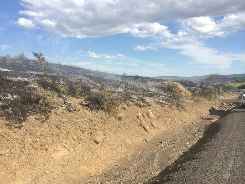 A brush fire northwest of Yakima is now 100% contained.
