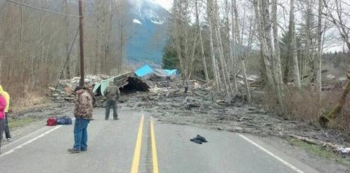 A stretch of Washington state highway that was buried in the deadly March 22 Oso mudslide reopened Friday afternoon to two-way traffic.