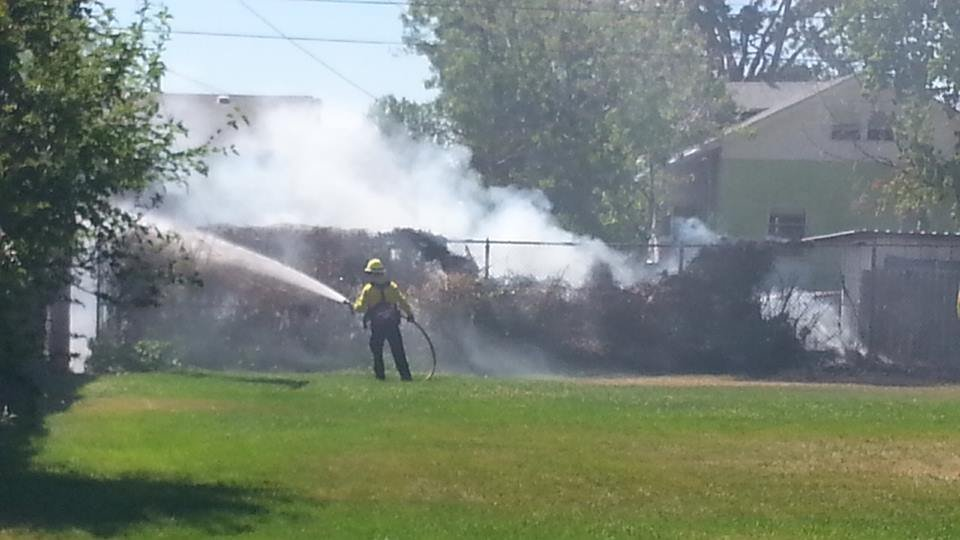 Firefighters in Pasco quickly put out a fire along a fence before it could spread to nearby houses Monday afternoon.