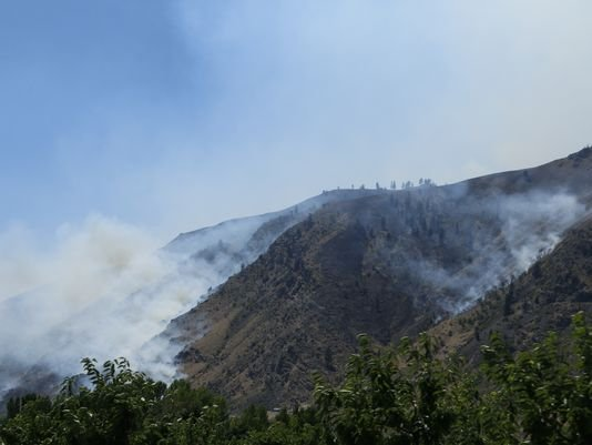 Staff at the Department of Transportation said a six-mile stretch of State Route 14 is closed in both directions right now because of a brush fire near the Washington-Oregon border.