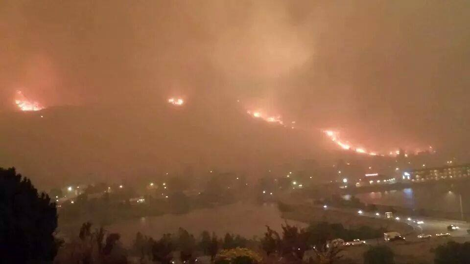 A sheriff estimates up to 100 homes have been lost in a large wildfire burning in north-central Washington.