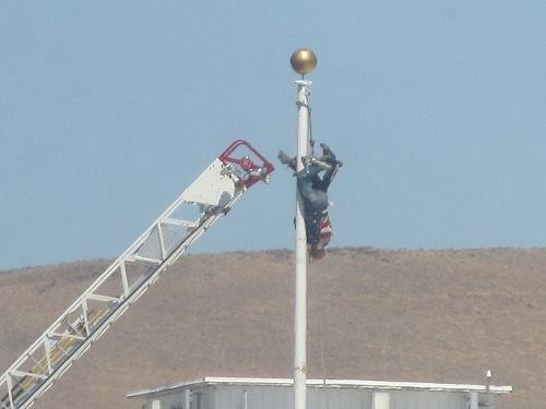 A man in Yakima is doing okay now after firefighters rescued him from a 30 foot flag pole Monday afternoon.