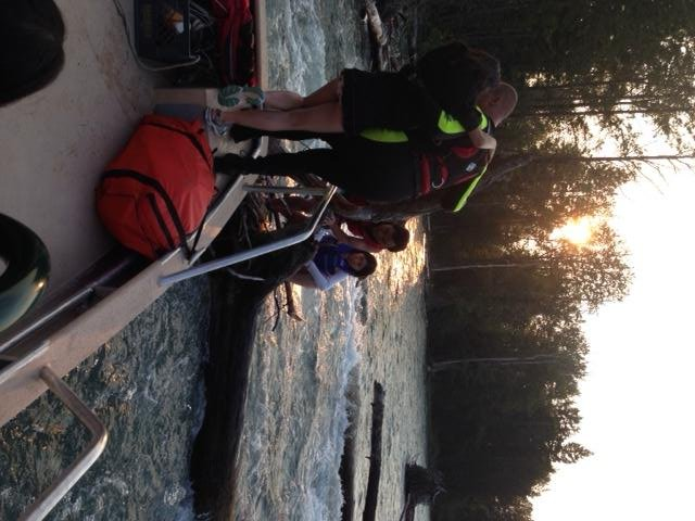 Sheriff's Deputies on a boat rescued a family of six trapped in a log jam in the Upper Cle Elum River.