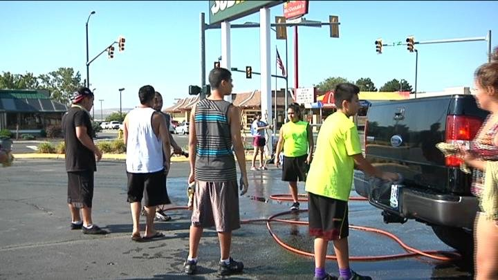 A car wash helps raise funds for triple homicide victims.