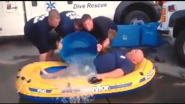 We have all by now heard of the ALS ice bucket challenge well some of Columbia Basin Dive and Rescue team members gave it whole new meaning Tuesday using 200 pounds of ice.