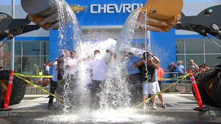 A local group of car dealerships claims to have done the largest ALS Ice Bucket Challenge in the northwest Friday.