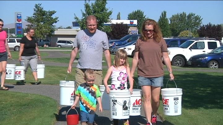Participants carried water to bring awareness for countries without clean drinking water.