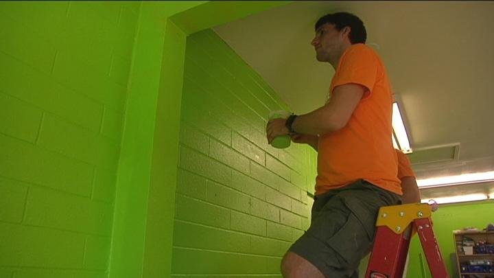 Volunteers helped paint the boys & girls club.