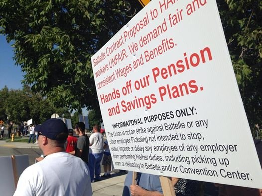Some workers from Pacific Northwest National Laboratory picketed in front of PNNL's anniversary celebration at the Toyota Center Wednesday.