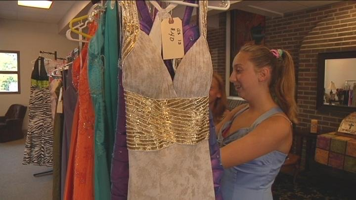 Teens looked through the dresses that the church displayed.