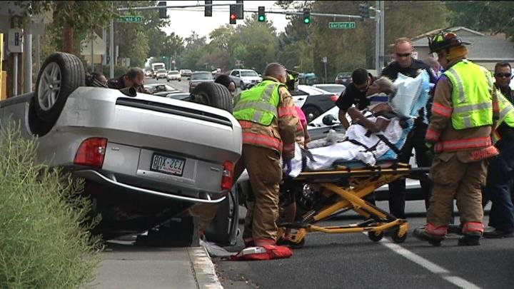 Everything came to a stop in front of Park Middle School in Kennewick Monday. Two people were trapped inside a rolled-over car on 10th Avenue around 11:30 in the morning.