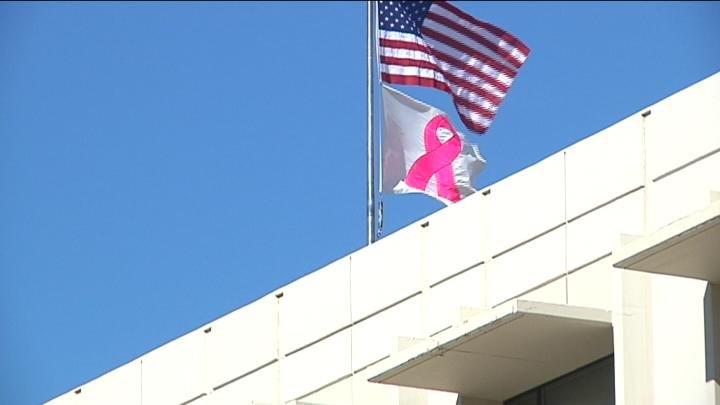 Survivors had a chance to raise the flag for Breast Cancer Awareness Month.