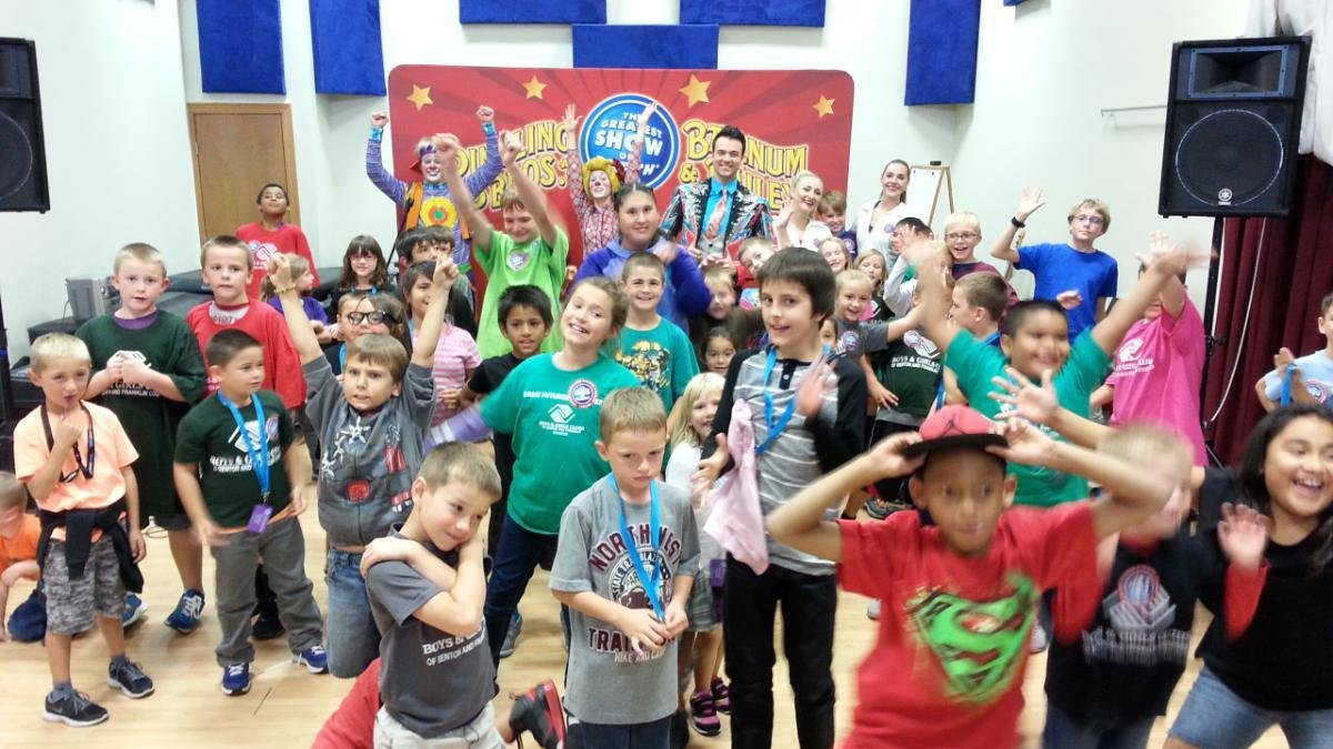 Circus performers visit Boys & Girls Club students