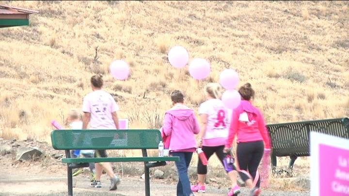 Walkers carried balloons as they climbed up Badger Mountain.