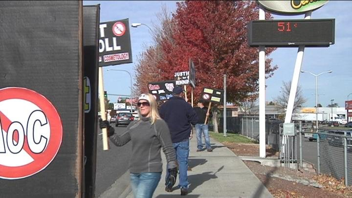 Protesters held signs and rallied against the Academy of Cosmetology.
