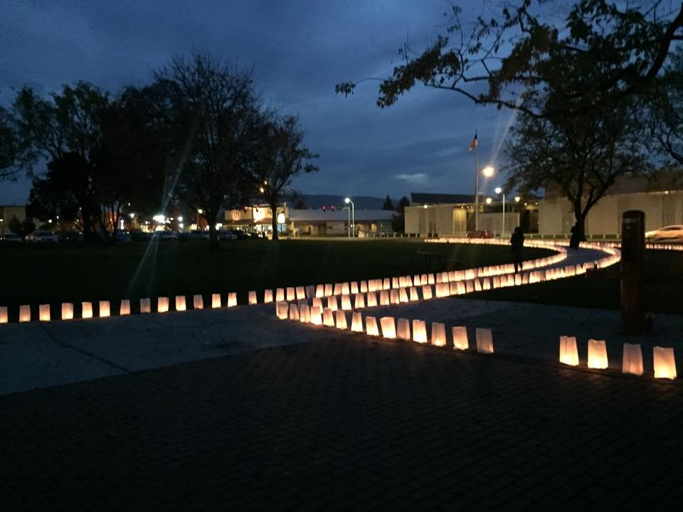 Dozens of people came together Thursday night at John Dam Plaza in Richland to honor those lost by domestic violence.
