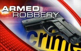 The sales clerk and a second employee said the men came in the store, took an undisclosed amount of cash and demanded cash from the clerk's wallet.