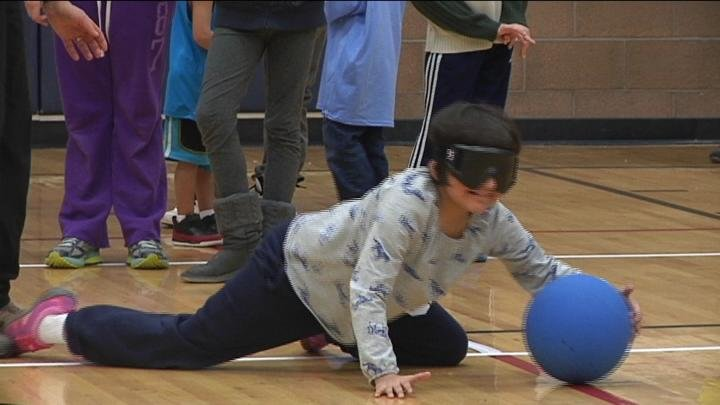 Kids and their families had a chance to put on the blindfolds and see just how hard it was to stop the ball.