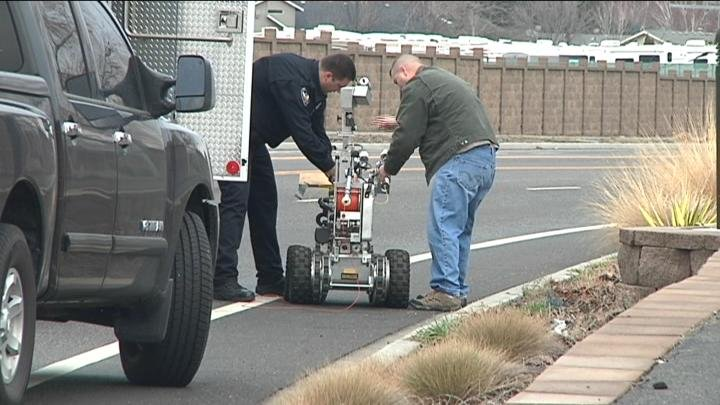 Technicians operate the robot that is used to handle explosive devices.