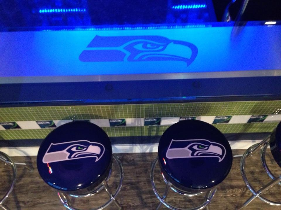 Szendre has bar stools with the Seahawks' logo on them.