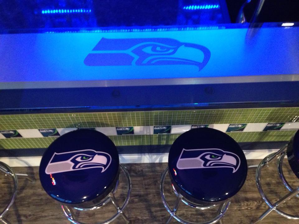 Szendre has bar stools with the Seahawks' logo on them.
