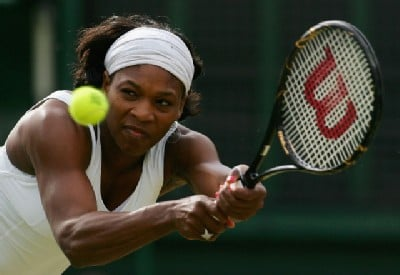 Alex Livesey/Getty Images - With her left hand bothering her, Serena Williams had difficulty with her backhand.