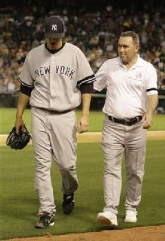AP - Mayday! Mayday! Phil Hughes walks to the dugout with Yankees trainer Gene Monahan after getting injured in the seventh inning on May 1.