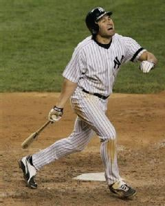 AP - Johnny Damon reacts upon turning his ankle while popping out in a 15-11 loss to the Seattle Mariners on May 4.