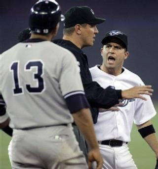 AP - Toronto's John McDonald has words with Alex Rodriguez during the ninth inning on May 30 after Toronto infielder Howie Clark accused A-Rod of shouting, 'MINE,' while Clark was fielding a popup.
