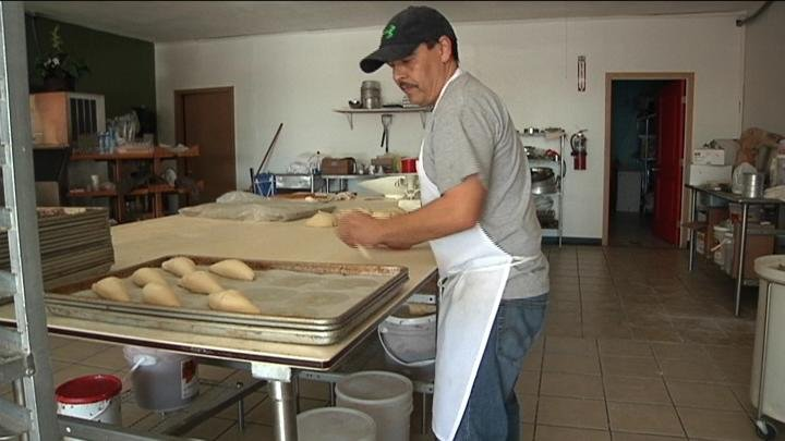Marin wakes up early to bake bread for the day and hopes to continue his business.