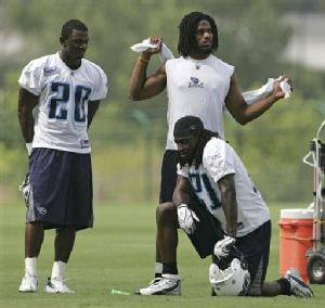AP - The Titans' defensive backfield gains a few players, like Michael Griffin, standing at right, and Nick Harper, left.