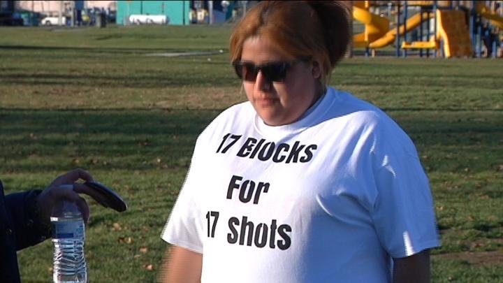 "Protestors wore ""17 blocks for 17 shots"" shirts."