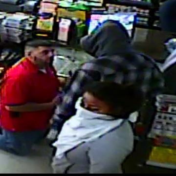UPDATE: Pictures Released of Armed Robbery When Cashier was Shot In Chest