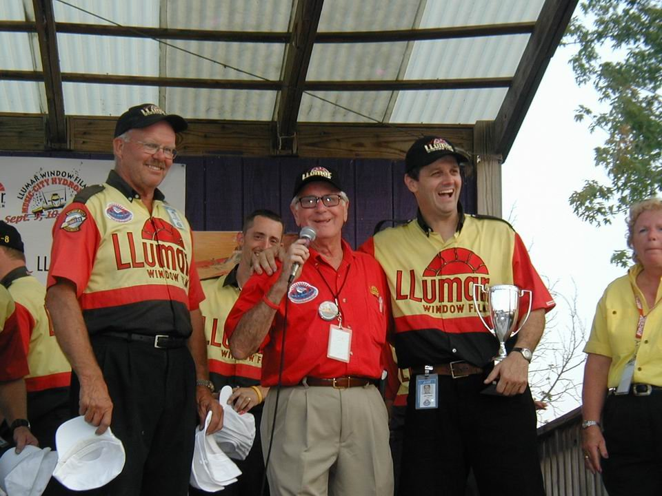 Bill Wurster at the microphone with the U-8 Llumar team after winning the Nashville race