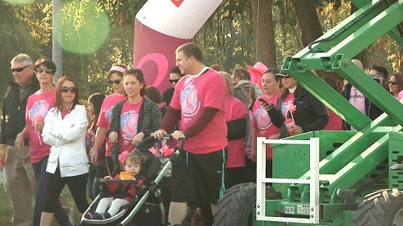 Supporters lined up in pink to raise money and awareness to fight Breast Cancer.