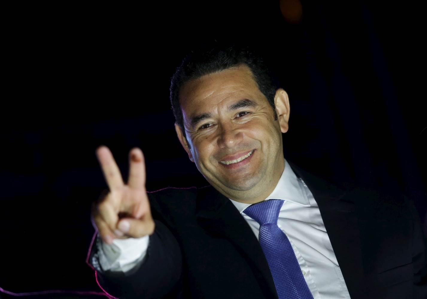 Jimmy Morales gestures to supporters after winning Guatemala's presidential election early Monday. JORGE DAN LOPEZ / Reuters