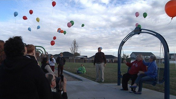 Balloons were released in the air around the memorial swing.