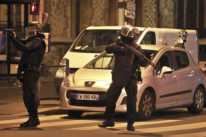 Police officers take up positions in Saint Denis, a northern suburb of Paris, Nov. 18, 2015. Photo by Thibault Camus/AP