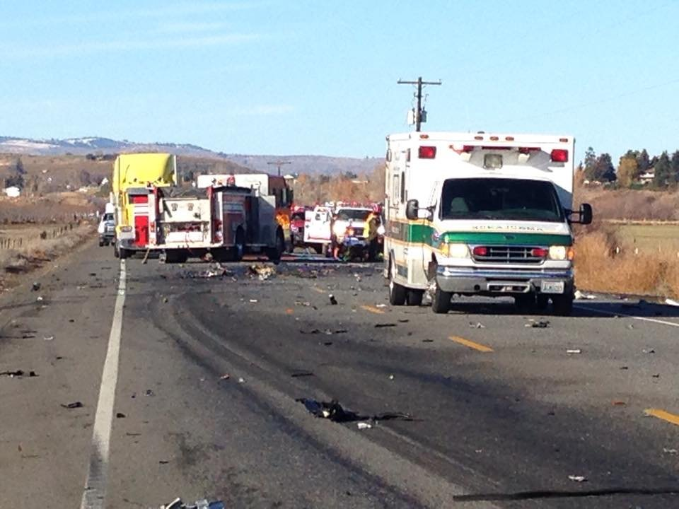 A collision involving a semi-truck and car has closed Summitview Avenue and North Pioneer Way near Cowiche in Yakima County.