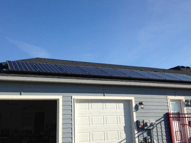 Solar panels are attached to the roof of the home.