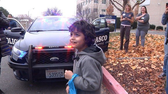 Miguel got to see the inside of a police car.