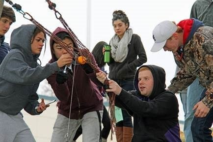 RHS Students go outside for pumpkin launching physics lesson