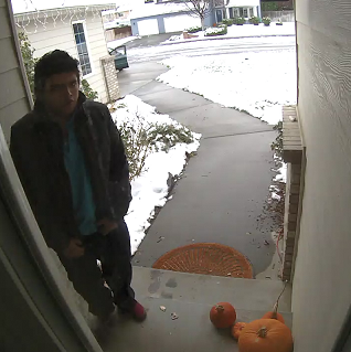 This is the person that grabbed a package off of a front porch.