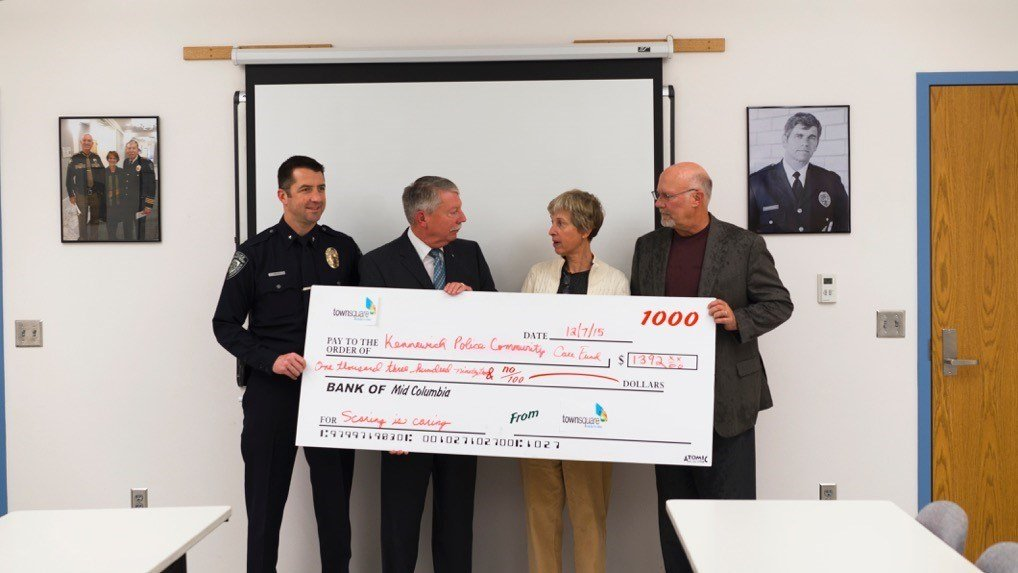 Pictured from left Commander Trevor White, Chief Ken Hohenburg, Cheryl Salmone of Town Square Media, and Dave Retter of Windermere Tri Cities