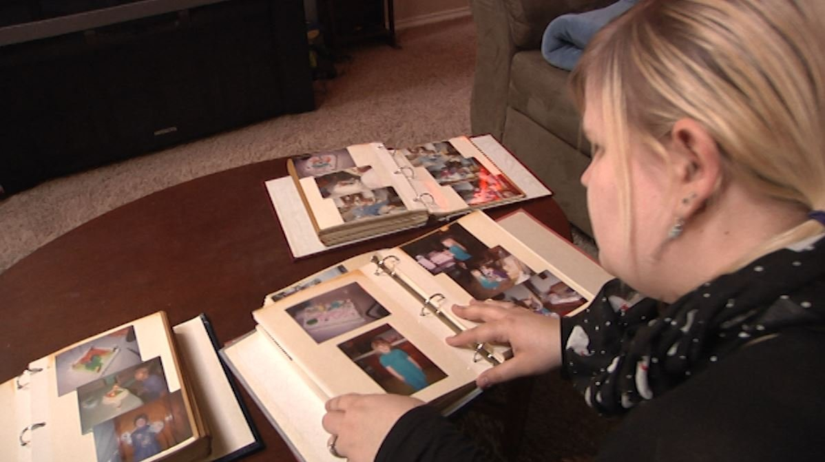 Breanna Carlson looks through photos of previous birthdays