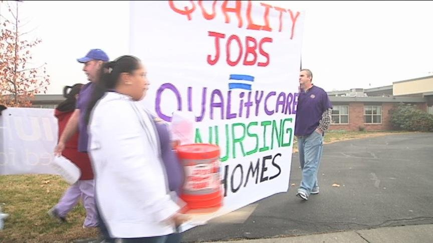 Dozens of nursing home workers picketed outside a Sunnyside nursing home Wednesday.