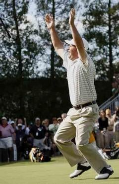 Getty Images - Brian Bateman raises his arms in exaltation after sinking the winning putt on the 18th hole.