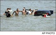 2006:  Car that careened through crow landed in the water